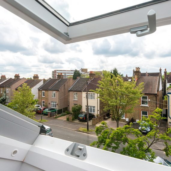 view from open window in loft conversion