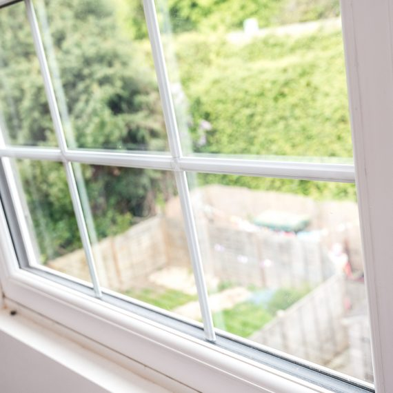close up of white sash window