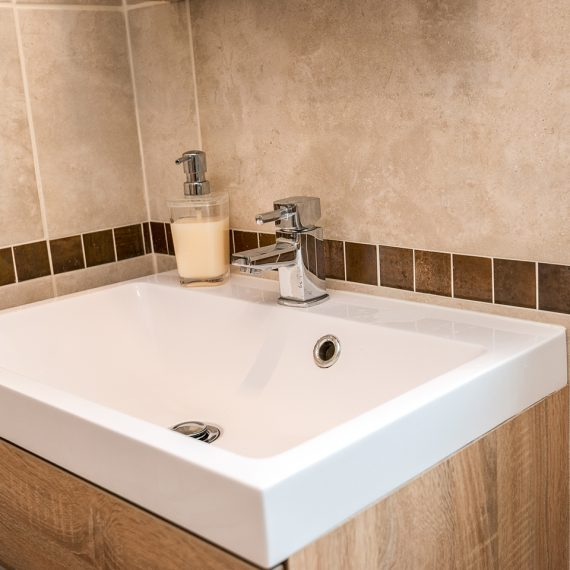 new sink unit with tiled walls