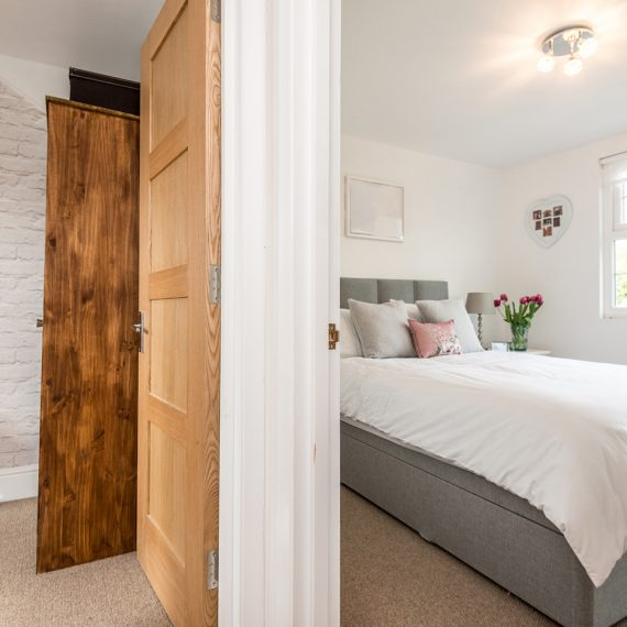 bedroom with walk in wardrobe