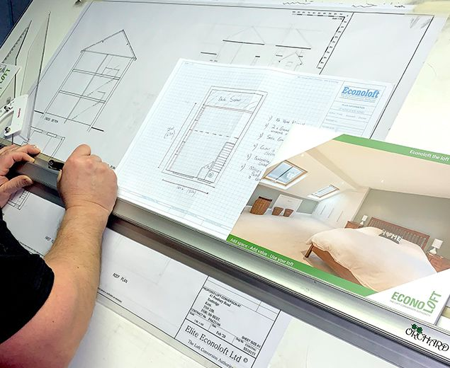loft conversion plans being drawn by draughtsman